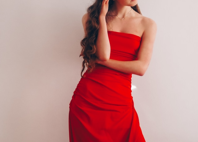 woman in red tube dress