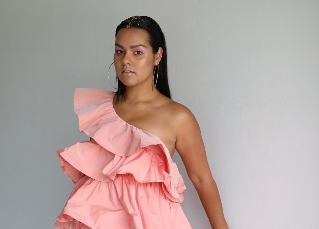 woman in pink one-shoulder dress