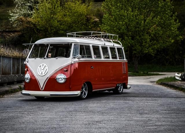 white and red Volkswagen van on road