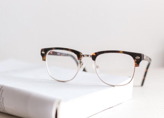 clear eyeglasses on book
