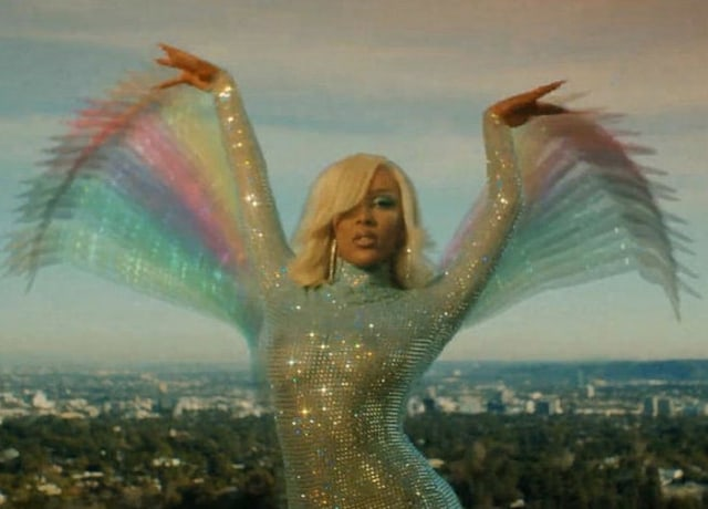 Doja Cat in a shimmery body suit against the city as the backdrop