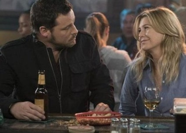 Meredith and Alex stare at each other while having a drink at their favorite bar.