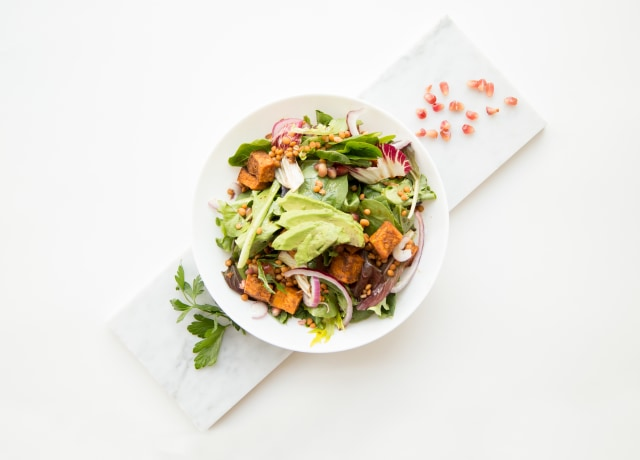 cooked food with sliced vegetables in white bowl