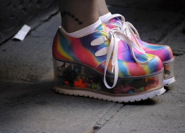 person wearing multicolored wedge shoes