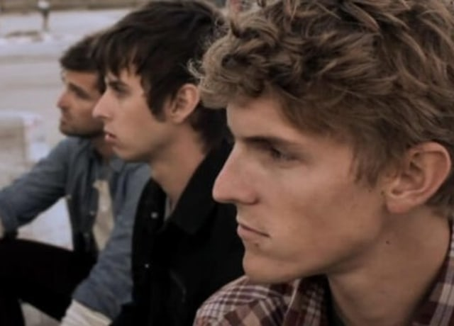 Band members from Foster The People staring into the distance