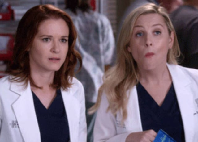 April looks increasingly worried as Arizona is mid chew on her chip snack.