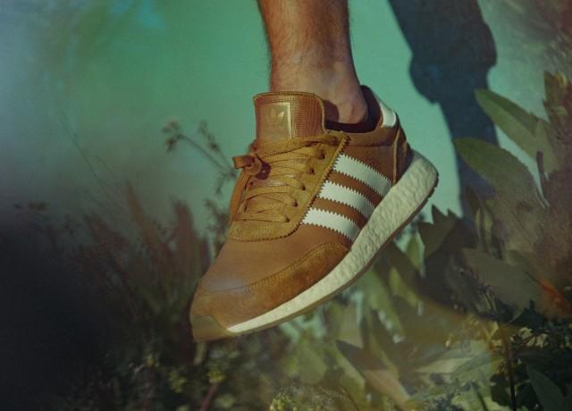 person wearing brown adidas shoe