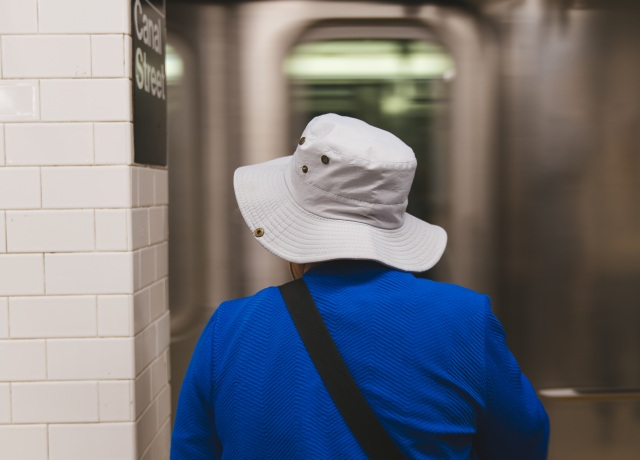 person waiting on a train station