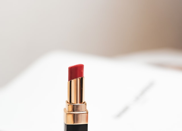red lipstick on white surface