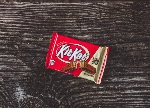 kitkat chocolate pack on black textile