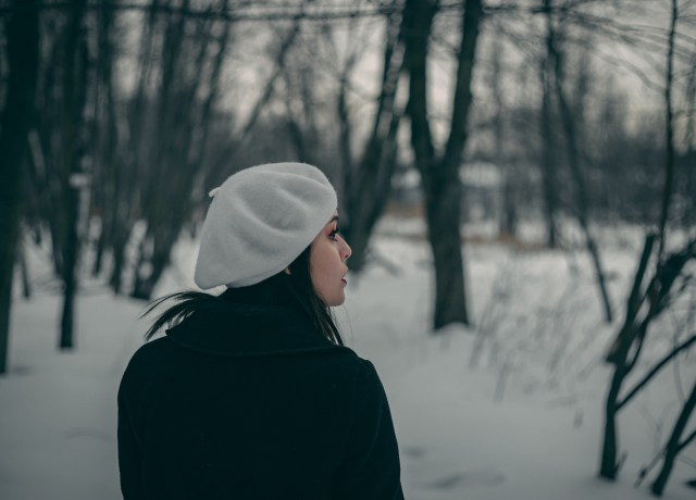 woman looking to the left standing on snow