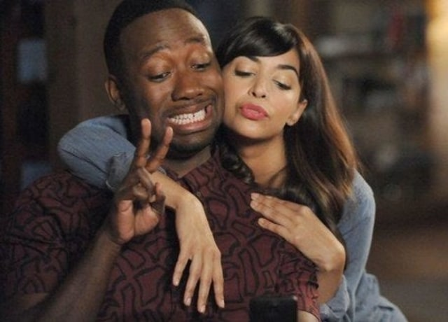 CeCe and Winston take a selfie with CeCe doing duck lips while Winston holds up a peace sign and smiles slightly.