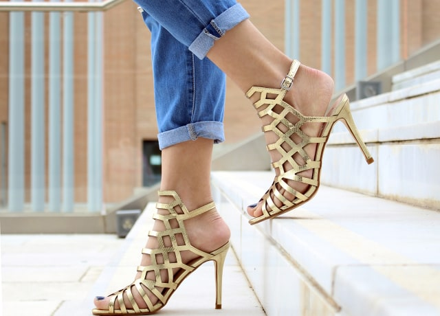 woman wearing brown leather heeled sandals walking on staircase