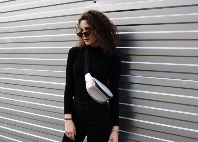 standing woman near wall
