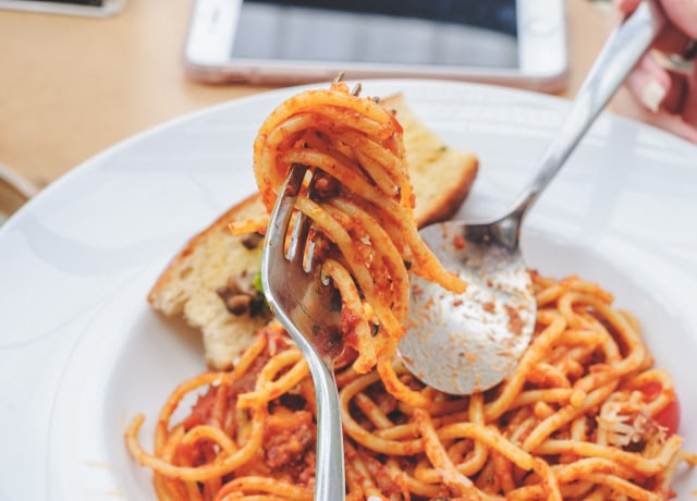 selective focus photography of fork with spaghetti