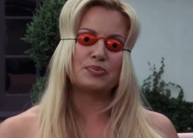 Fiona with tanning goggles on as she talks to Sam.