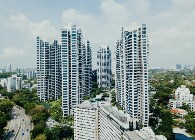 white high rise buildings under white clouds