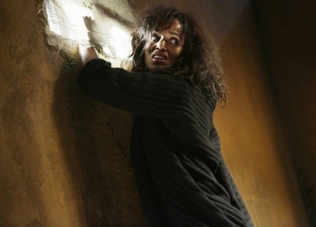 Kerry as Olivia trying to escape out a window
