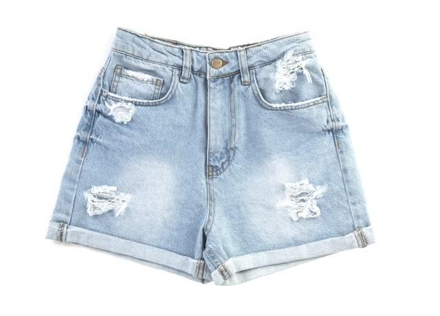 blue denim shorts on white surface