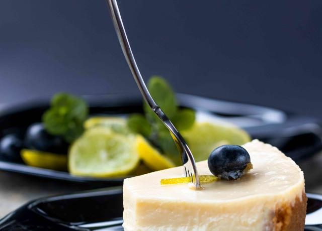 sliced cake on black plate