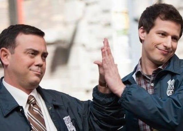 Charles and Jake hold their hands together in a high five.