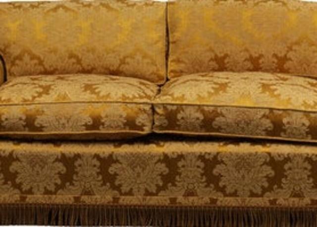 Estofado de jacquard dourado com estampa florida