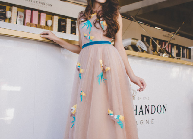 woman wearing peach-colored maxi dress