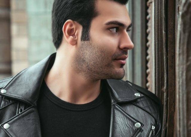 man wearing black leather biker jacket