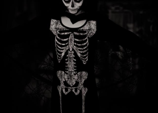 person wearing skeleton costume