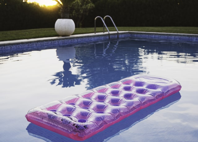 pink inflatable ring on swimming pool