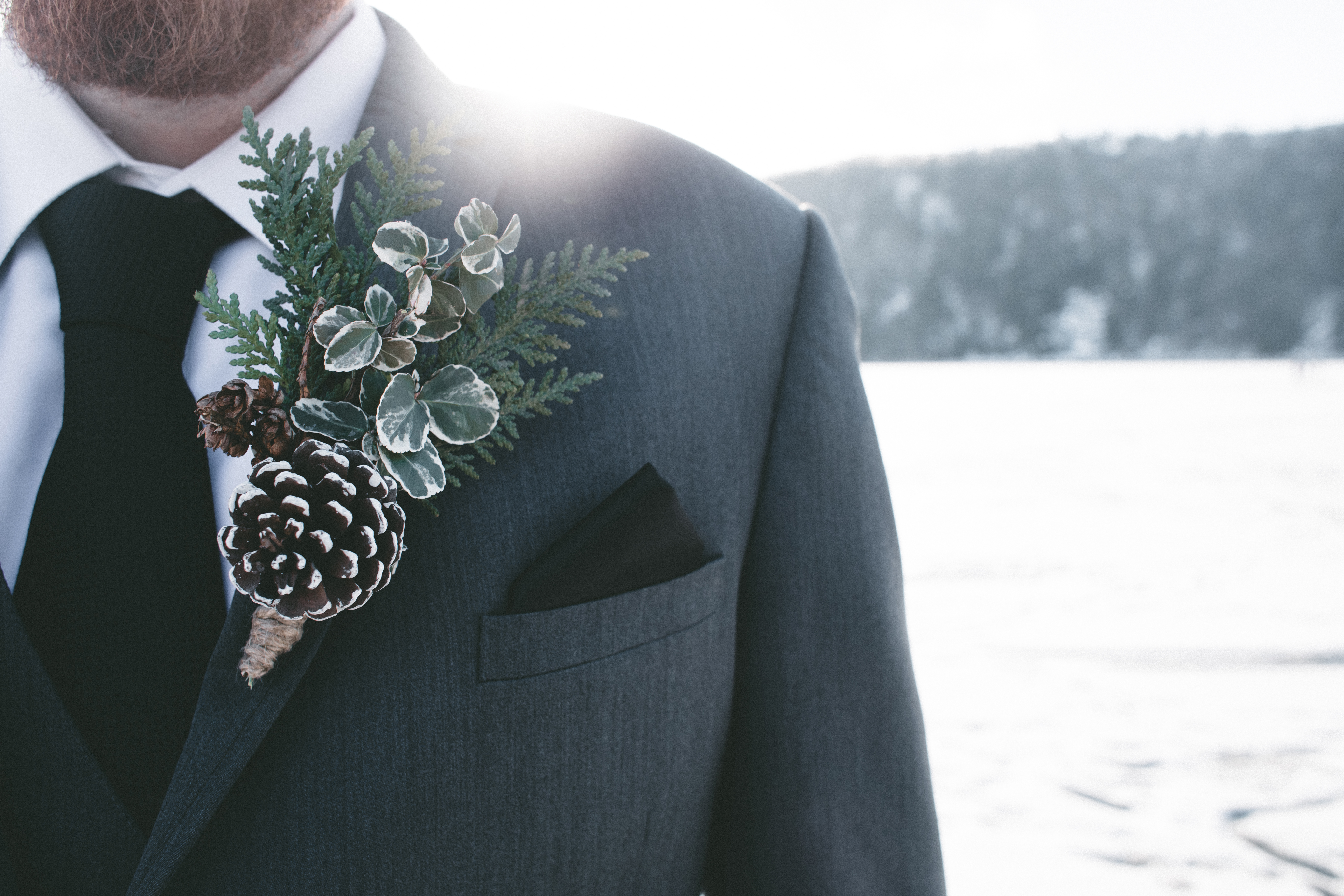 man in gray blazer with corsage