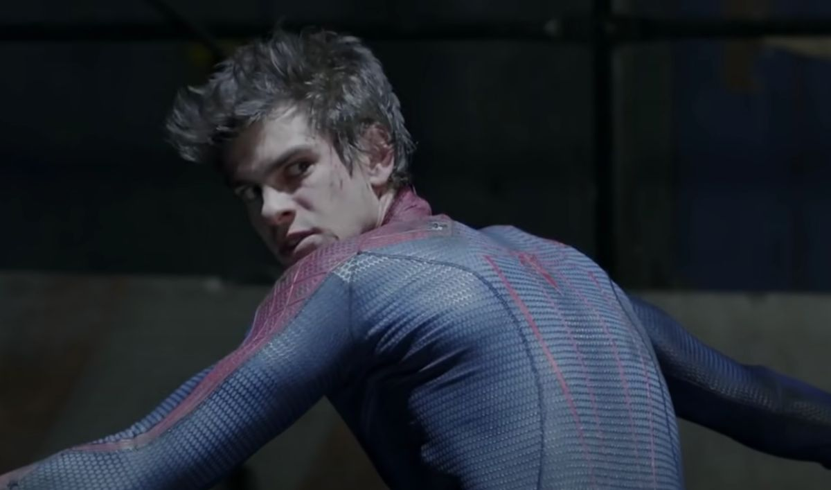 Spider-Man is in an alley with his head turned to the back