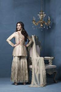 Influenced by timeless royal fashion, a straight dupion kurta with indian zardoze  worn over shimmer sharara by Designer Rashi Kapoor