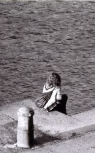 Girl Grieving by the sea