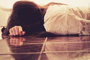 Suicidal lady on floor