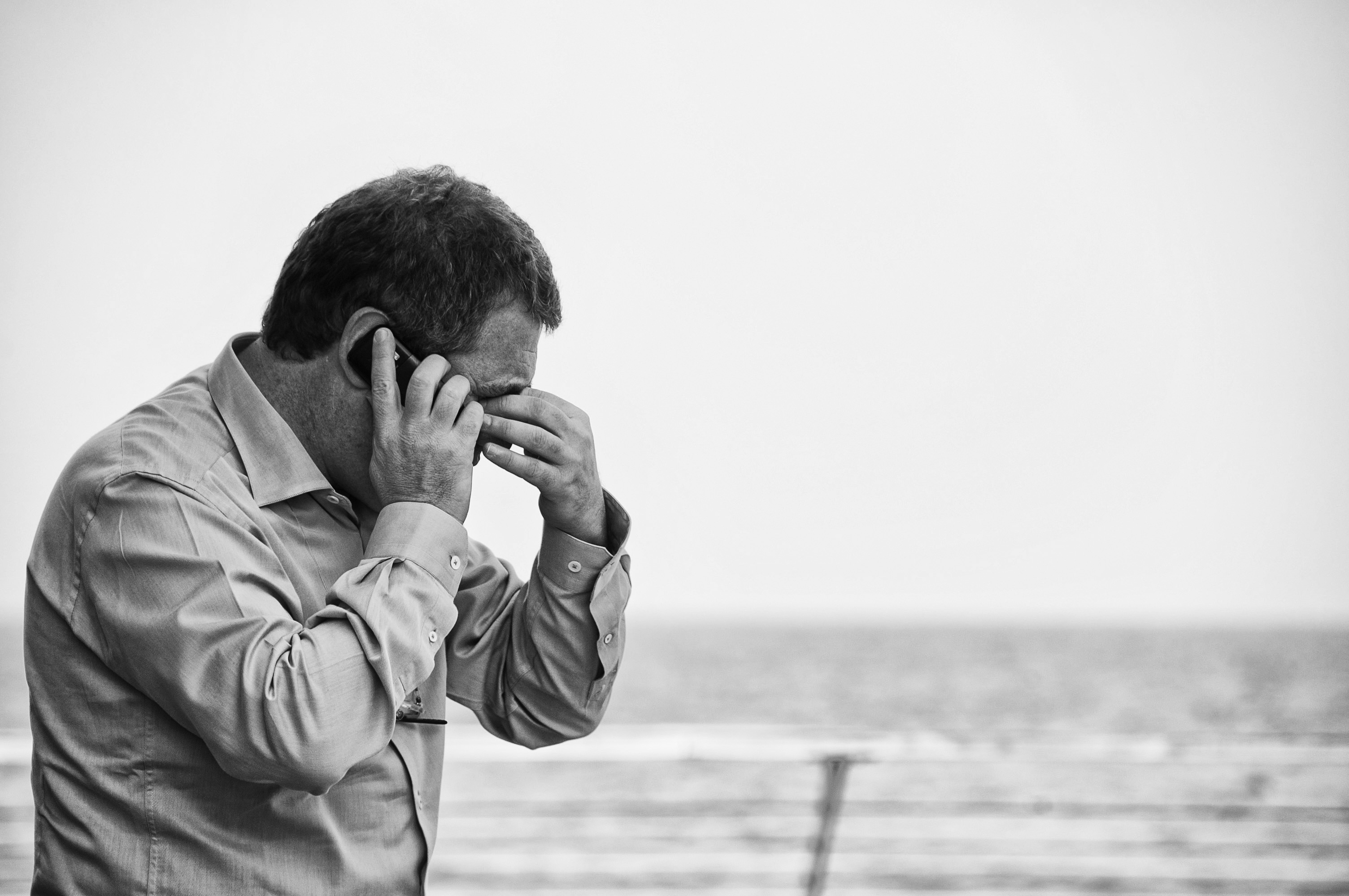 Stressed man on phone