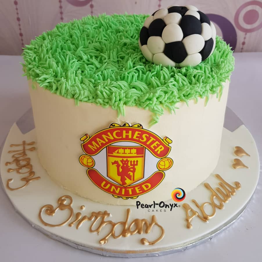 for the red devils fans 2 layers buttercream cake vanilla and strawberry flavours with manu logo and soccer field and ball theme cake market great manchester united