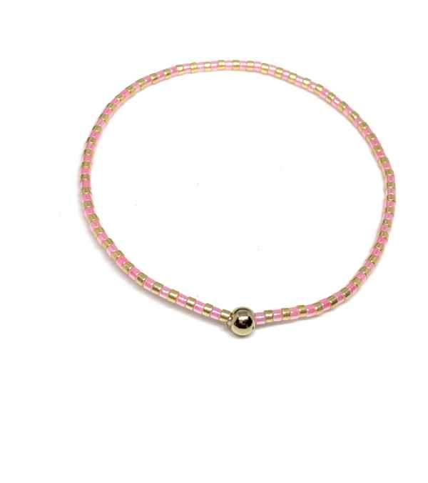 Pulsera mostacilla oro 14 kilates y cristal rosa