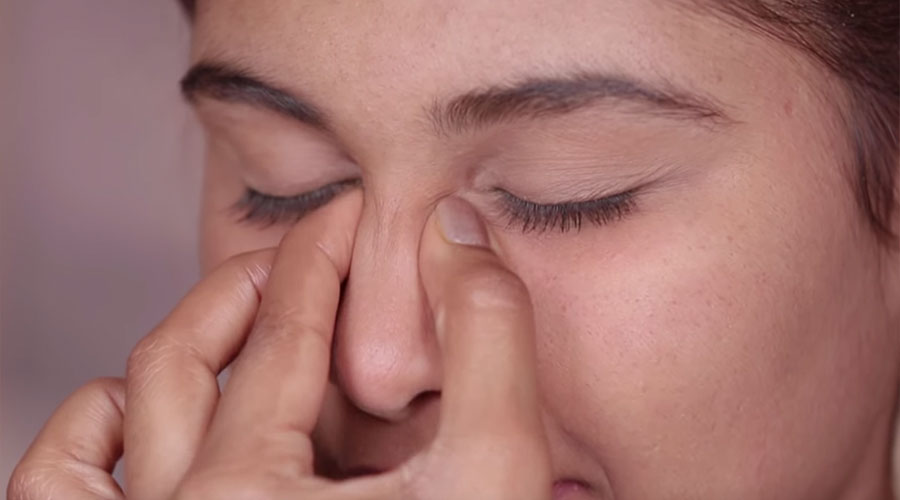 Gently pinch your nose from the tip all the way to the center of your forehead. Repeat the process 3 or 4 times.