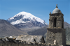 Framed by a church built c. 1886, Nevado Sajama (21,464 ft above sea level) rises behind the village of Sajama in western Bolivia. Ice cores taken from the summit detail global-scale changes in climate.