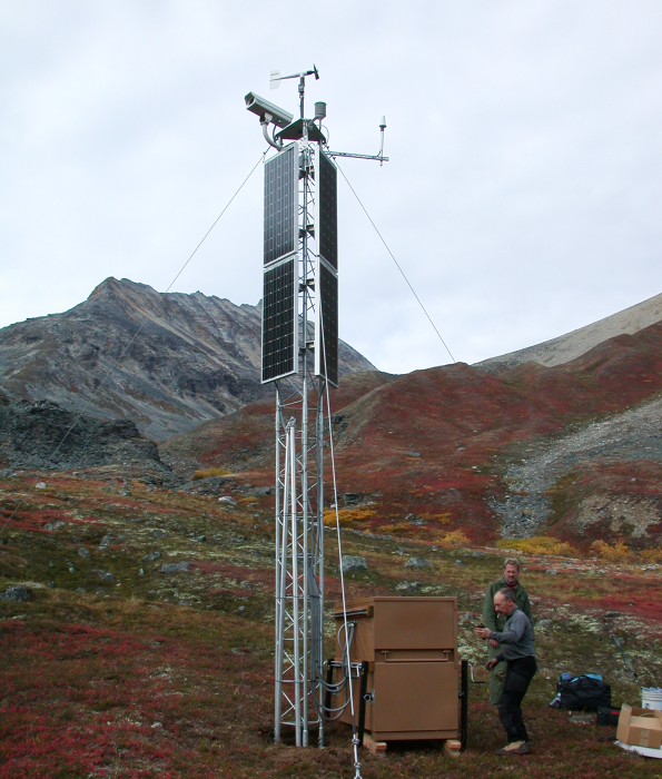 A digital camera and meteorological sensors deployed atop a guyed tower in an Alaskan mountain pass