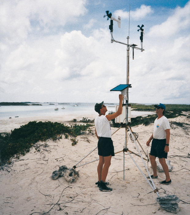 Heinz Proft (left) and Dr. George Dennis inspect a weather station at Warderick Wells Exuma Land and Sea Park, Exuma Cays, Bahamas.