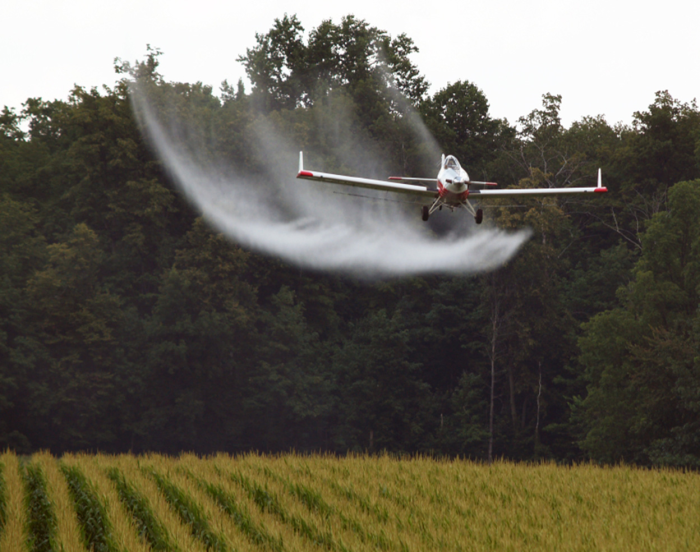 In Alberta, crop dusting is only permitted under certain wind conditions
