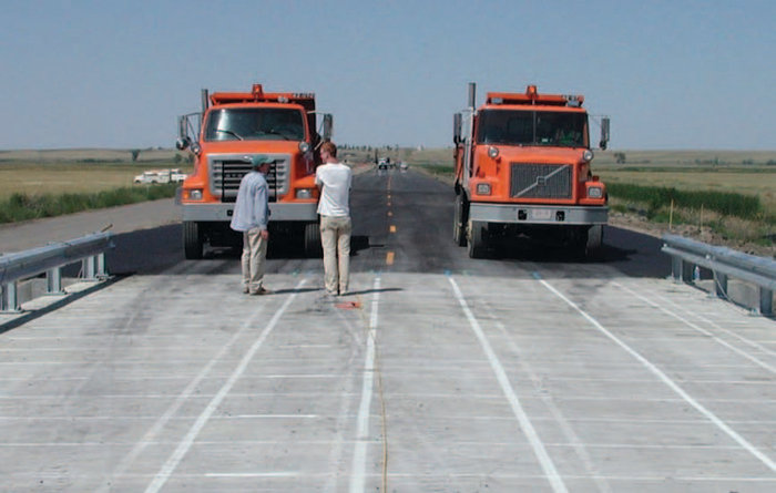 Researchers prepare for a two-truck live load test in order to reach one of the objectives of the Montana highway project, which is to compare load-carrying mechanisms of three different bridge decks near Saco.