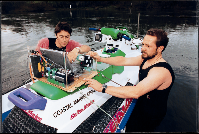 John Radford (left) and Dirk Immenga make final adjustments on the Seadoo-based system before taking a test ride.