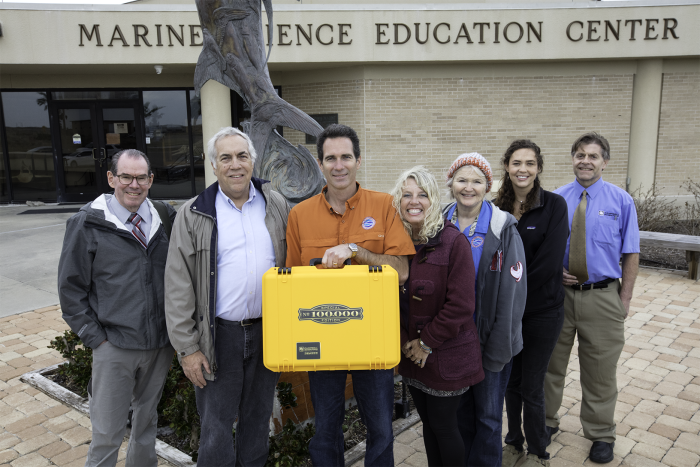 Mission-Aransas NERR employees with golden datalogger case