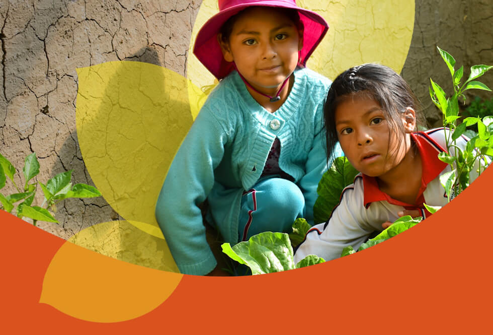Two Bolivian girls working in their family garden