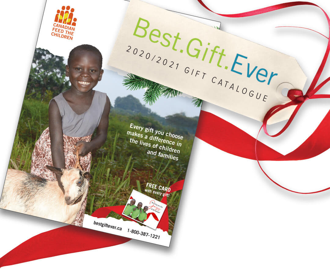 Abiriya on the cover of the 2020/2021 Best.Gift.Ever catalogue holding one of her families goats