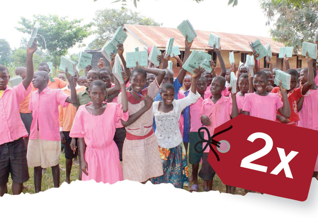 Charity Gifts for Teachers including school supplies. Image shows African children holding up school supplies.