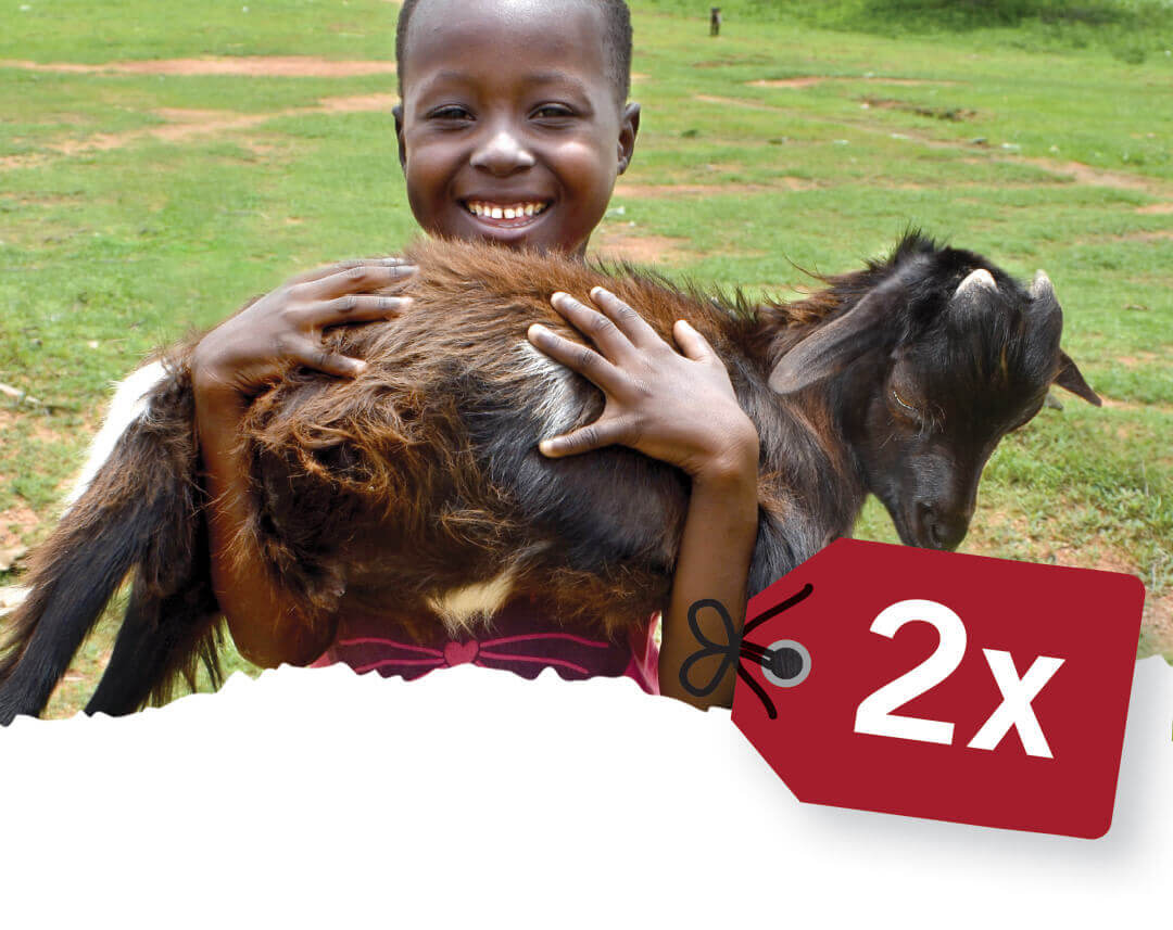 When you give a goat for Christmas real families benefit. Image shows African girl holding a goat.